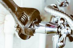 Plumbing in the bath tube stock image
