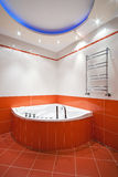Bathroom in orange and white colors Royalty Free Stock Photography