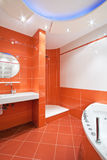 Bathroom in orange and white colors Stock Photo