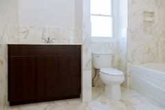 Bathroom with oval marble sink and shower curtain. Beautiful new master bathroom stock photography