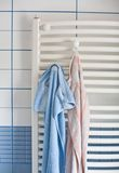 Bathroom radiator with towels Royalty Free Stock Image