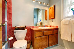 Bathroom with red tile wall trim Stock Images