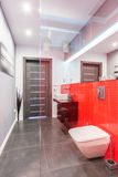 Bathroom with red tiled wall Stock Photo