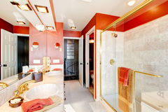 Bathroom with red walls and walk-in shower. Stock Image