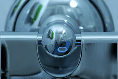 Bathroom reflection. Reflection of the bathroom into a stainless steel toilet paper holder Stock Photo
