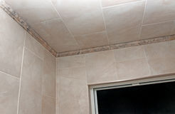 Bathroom Remodeled. New remodeled bathroom with porcelain tile and crown molding Stock Images