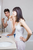 Bathroom routine for happy young couple Stock Photos
