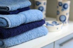 Bathroom's towels. Blue bathroom's accessories and towels Royalty Free Stock Photography