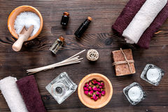 Bathroom salt and natural soap for spa on wooden background top view Stock Photography