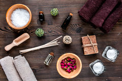 Bathroom salt and natural soap for spa on wooden background top view Stock Images