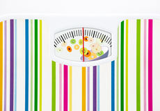 Bathroom scale with bowl of fruits on dial Royalty Free Stock Images