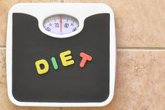 Bathroom scale with Diet text Royalty Free Stock Images