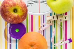 Bathroom scale with fruits and diet text Stock Photography