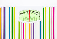 Bathroom scale with fruits,vegetables and forks Royalty Free Stock Photo