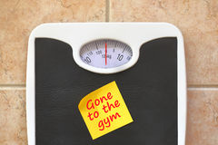 Bathroom scale with Go to Gym memo sticker. Diet and fitness concept Stock Photography