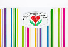 Bathroom scale with heart on dial Royalty Free Stock Images