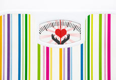 Bathroom scale with heart on dial Stock Photos