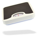 Bathroom scale jumping in the air Royalty Free Stock Photos