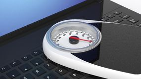 Bathroom scale on laptop Stock Images