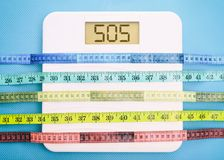 Bathroom scale and measure tapes. On a blue background Stock Image