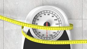 Bathroom scale with measuring tape. Closeup on bathroom floor Royalty Free Stock Photos