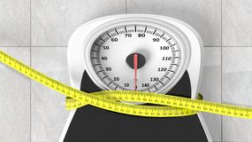Bathroom scale with measuring tape squeezing it. Closeup on bathroom floor Royalty Free Stock Photo