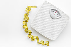 Bathroom scale and measuring tape on white background top view copyspace Royalty Free Stock Photo