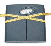 Bathroom scale and tape measure Royalty Free Stock Photo