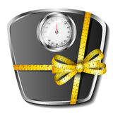 Bathroom scale with tape measure bow. Analogue bathroom scale with yellow tape measure bow eps10 Royalty Free Stock Images