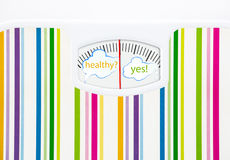 Bathroom scale with text bubbles on dial Royalty Free Stock Photos