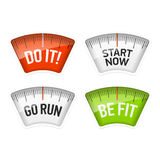 Bathroom scales displaying Do It, Start Now, Go Run and Be Fit messages Royalty Free Stock Photography