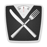 Bathroom scales with fork and knife. Stock Image