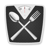 Bathroom scales with fork and spoon. Royalty Free Stock Image