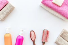 Bathroom set. Towels, bottles with soap and shampoo, cobs on white backgrond top view copyspace Stock Photography