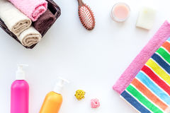 Bathroom set. Towels and bottles with soap and shampoo on white backgrond top view copyspace Stock Photo