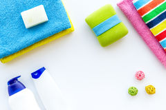 Bathroom set. Towels, bottles with soap and shampoo on white backgrond top view copyspace Royalty Free Stock Photos
