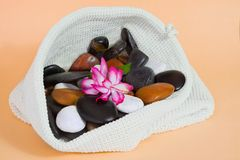 Bathroom set and wellness stones. In whites bag Stock Photos