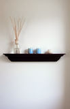 Bathroom shelf. Shelf in a bathroom with air freshener and candles Stock Image