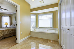 Bathroom with shiny tile floor in master bedroom Stock Image