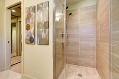 Bathroom shower with glass doors and natural color tiles. Stock Images