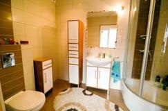 Bathroom shower interior. Modern bathroom interior, transparent glass shower cabin, elegant tiles, modern design.Interior of modern light colours bathroom.  Wide Stock Photos