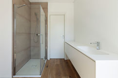 Bathroom with shower and sink Stock Photos