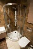 Bathroom shower. Vertical view of shower designed in dark bathroom royalty free stock image