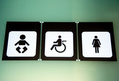 Bathroom sign. For women, babies and disabled stock image