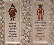 Bathroom Sign. Multiple language male and female bathroom sign Stock Photo
