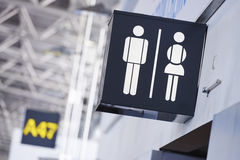 Bathroom sign in airport Stock Photos