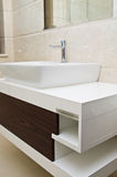 Bathroom sink and cabinet. A modern white bathroom sink and cabinet royalty free stock images
