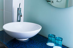 Bathroom sink counter tap mixer glass blue Stock Photos