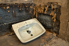 Bathroom sink on the floor. HDR image of a stripped bathroom. Water was leaking inside the walls and everything had to be stripped away and dried before building Royalty Free Stock Images