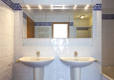 Bathroom sink and mirror Stock Images